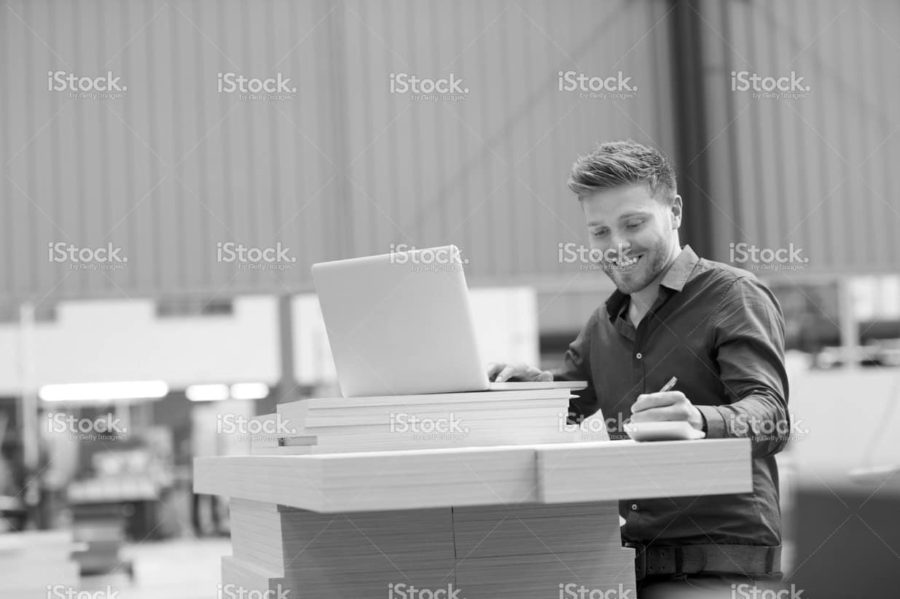 stock-photo-56628808-young-warehouse-worker-tracking-the-delivery.jpg
